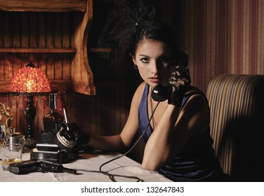 Woman portrait  in retro style with phone and cigarette.