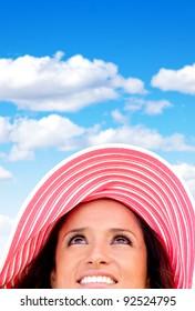 Woman portrait wearing a summery hat on a beautiful day