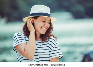 woman portrait in white fedora hat