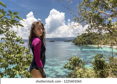 Woman pose on the tropical island with palms tree on the beach. Asian travel to the Philippine islands