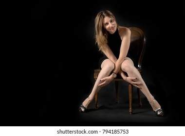 woman posing against a black background