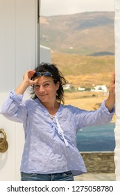 Woman posing at Andros island in Greece.