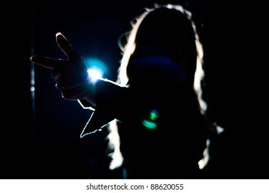 Woman posing in a backlight situation