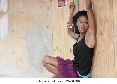 Woman posing by a construction site