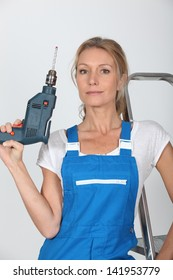 Woman posing with a drill