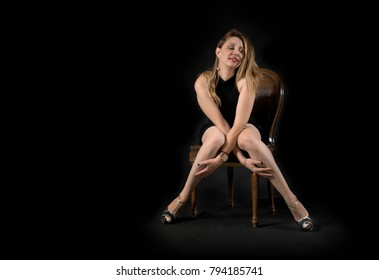 woman posing with eyes closed