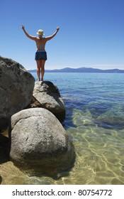 Woman posing on a rock on Lake Tahoe