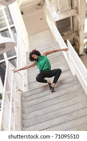 Woman posing on the staircase