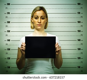 woman posing for police mugshot