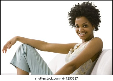 Woman posing and relaxing on sofa