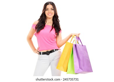 Woman posing with shopping bags isolated on white background