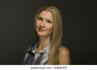 Woman posing in studio, horizontal