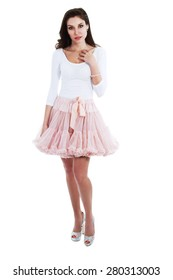 woman posing in tutu princess skirt and high heels over white