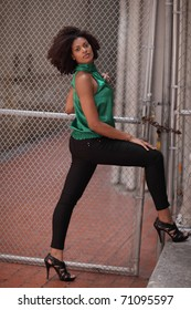 Woman posing in an urban setting