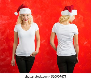 Woman posing in white t-shirt and Santa hat