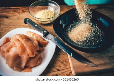 Woman Pouring breadcrumbs in to the plate