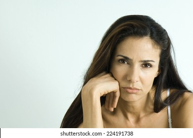 Woman pouting, looking at camera, portrait