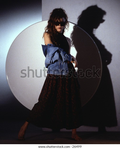 Woman pposing in front of circle in a studio
