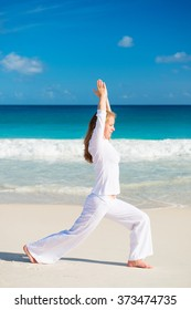 Woman practices morning exercises on the beach