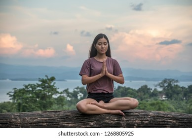 Woman practices yoga and meditates  on the hill.Travel Lifestyle relaxation emotional concept adventure summer vacations outdoor harmony with nature