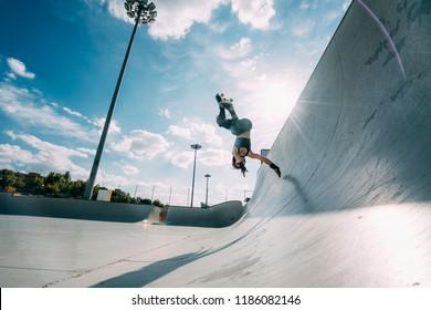 Woman practicing figure skating in skatepark. Madrid Spain.