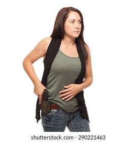 Woman Practicing Gun Safety and about to draw gun from holster | Attractive female shooter holding handgun against white background.