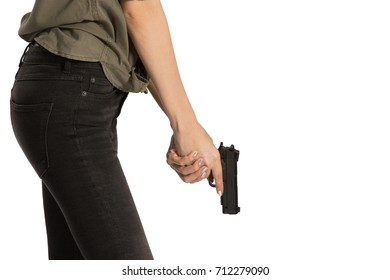 Woman Practicing Gun Safety with hand on gun on  white background.