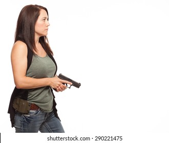 Woman Practicing Gun Safety at the ready position with copy space | Attractive female shooter holding handgun against white background.