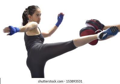 Woman practicing thai boxing technique.( Muay Thai)