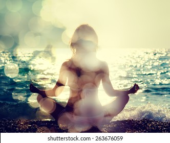 Woman Practicing Yoga by the Sea. Rear View. Double Exposure Filtered Photo with Bokeh. Soul Concept.