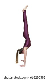 Woman practicing yoga in handstand pose isolated on the white background
