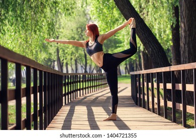 8aed4a489fb9c Woman practicing yoga outdoors, taking care of body and health. stand on  your hands