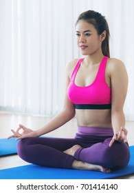 Woman practicing yoga pose in gym, close up view. Healthy lifestyle and wellness concept.