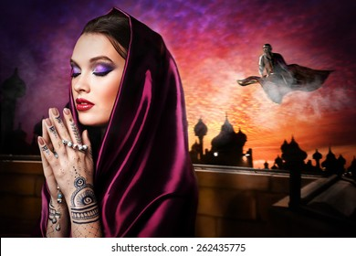 Woman praying  with mehendi on hands and wearing the hijab