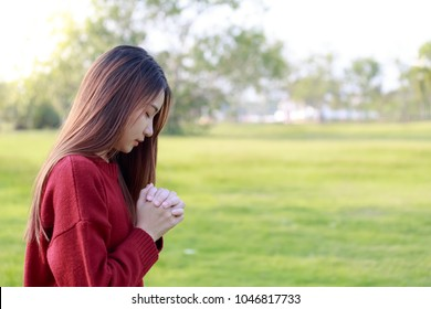 Woman praying in the morning. Woman praying on nature background. Women praying to god. Christianity concept. Pray background. Faith hope love concept.