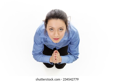woman praying on her kneels shot from a birds eye view looking down