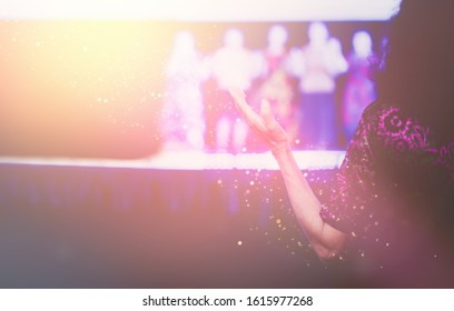 Woman praying and worship to GOD in Church.Senior woman raised hand and worship praise pray to GOD.Hand praying and palm up,Concept Praise and worship with faith, spirituality and Surrender.