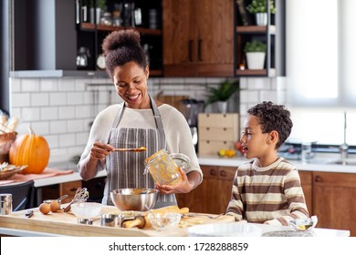 Woman prepare pie in the kitchen and learn his son cooking