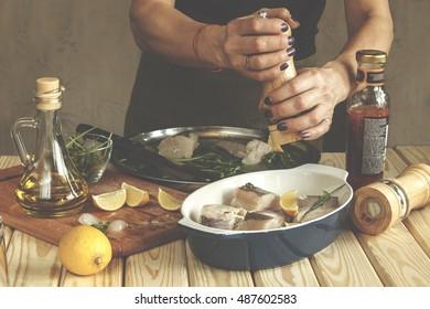 Woman prepares fish