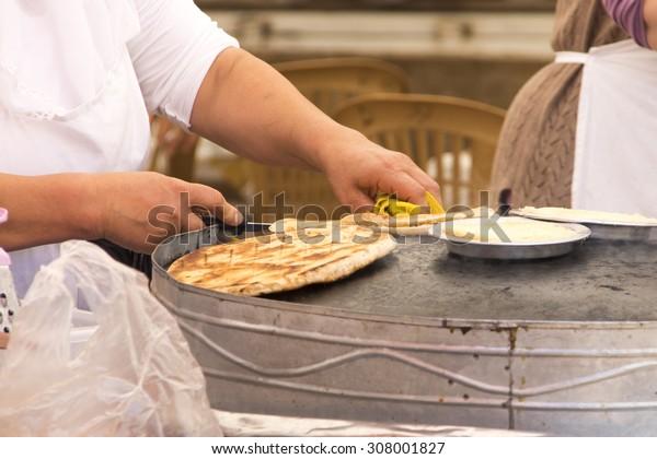 A woman prepares traditional Turkish pastries - gozleme