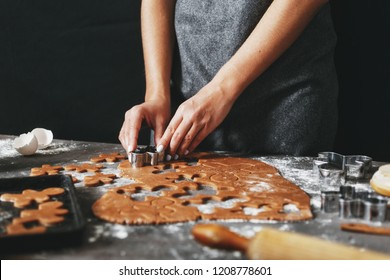 Woman preparing Christmas holiday cookies ginger men