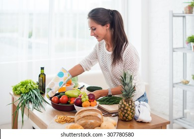Woman preparing dinner in a kitchen concept cooking, culinary, healthy lifestyle