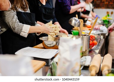 Woman preparing dough in the bowl. Culinary workshops