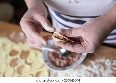 woman preparing dumplings hands