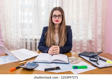 Woman preparing to fill 1040 form and for tax day