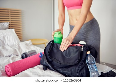 Woman preparing gym bag for all day