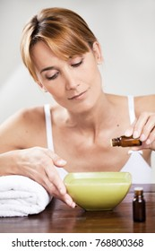 woman preparing a mixture with essential oils