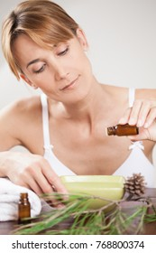 woman preparing a mixture with scots pine essential oils