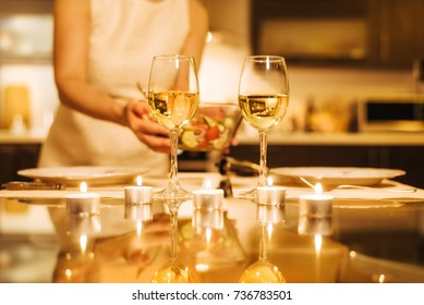 Woman preparing supper for two persons. Romantic concept .