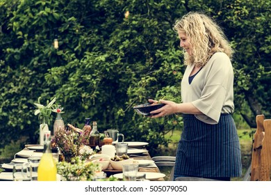 Woman Preparing Table Dinner Concept